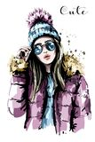 Hand drawn beautiful young woman in knit hat. Fashion woman in sunglasses. Stylish girl. Sketch Royalty Free Stock Images