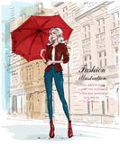 Hand drawn beautiful young woman with umbrella. Fashion woman with architectural background. Stylish girl in fashion clothes. Stock Photos