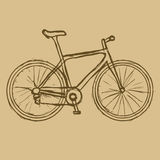 Hand drawn bicycle on the brown background. Vector image. Royalty Free Stock Photo