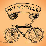 Hand-drawn bicycle on grungy background. Stock Images