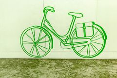 Hand drawn bicycle icon on green background Royalty Free Stock Photography
