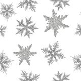 Hand drawn black and white snowflakes on the flat white background royalty free illustration