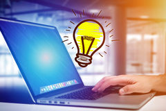 Hand drawn bulb lamp icon going out a computer interface of a ma. View of Hand drawn bulb lamp icon going out a computer interface of a man at the office - Idea Royalty Free Stock Photography