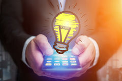 Hand drawn bulb lamp icon going out a smartphone interface of a. View of Hand drawn bulb lamp icon going out a smartphone interface of a businessman at the Stock Photography