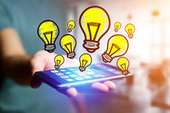 Hand drawn bulb lamp icon going out a smartphone interface of a. View of Hand drawn bulb lamp icon going out a smartphone interface of a man at the office Stock Photography