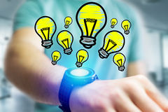 Hand drawn bulb lamp icon going out a smartwatch interface of a. View of Hand drawn bulb lamp icon going out a smartwatch interface of a businessman at the Royalty Free Stock Photo