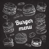 Hand Drawn Burgers on Blackboard. Fast Food Menu with Cheeseburger, Sandwich and Hamburger Stock Photography