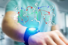 Hand drawn business icon going out a smartwatch interface of man. View of Hand drawn business icon going out a smartwatch interface of man at the office Royalty Free Stock Photo