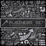 Hand drawn business icons set. With arrows, diagrams, puzzle pieces, thumbs up and more.  Chalkboard effect. Vector Illustration Stock Photos