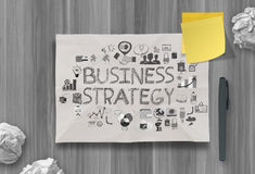 Hand drawn business strategy on crumpled paper background Stock Images