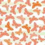 Hand drawn butterflies in hues of orange on subtly striped green and white water colour background. Seamless vector stock illustration