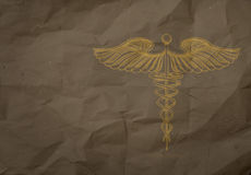 Hand drawn Caduceus on wrapping recycle paper background stock photos