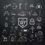 Hand drawn camping, hiking or mountain climbing icons set on bla Royalty Free Stock Image