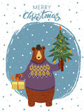 Hand-drawn cartoon bear. Wearing a sweater and a hat with a gift and a Christmas tree in his paws. Merry Christmas greeting card design. Vector illustration Royalty Free Stock Image