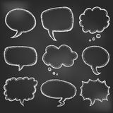 Hand drawn cartoon speech bubble on black board Royalty Free Stock Images