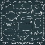 Hand-drawn chalkboard frames and elements set. Set of hand drawn chalkboard frames, borders and elements Royalty Free Stock Image