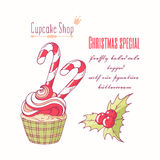 Hand drawn christmas cupcake with holly, candy cane and doodle buttercream for pastry shop menu. Vector illustration vector illustration