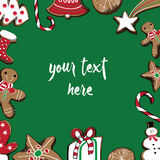 Hand drawn Christmas gingerbread cookies. Place for your text in the middle. Green background. Vector illustration of christmas cookies on sides on green vector illustration