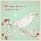 Hand drawn Christmas greeting card with bird sitting on twigs. Royalty Free Stock Photos