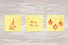 Hand-drawn christmas tree and red balls on three yellow stickers. Greeting card. Vector on wooden background. Hand-drawn christmas tree and santa claus and stock illustration