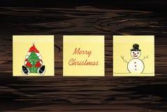 Hand-drawn christmas tree and santa claus and snowman on three yellow stickers. Greeting card. Vector on wooden background. Hand-drawn christmas tree and santa vector illustration