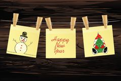 Hand-drawn christmas tree and santa claus and snowman on three yellow stickers. Greeting card. Vector on wooden background. Hand-drawn christmas tree and santa royalty free illustration