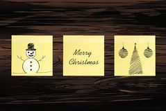 Hand-drawn christmas tree and snowman and red balls on three yellow stickers. Greeting card. Vector on wooden background. Hand-drawn christmas tree and santa royalty free illustration