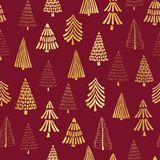 Hand drawn Christmas trees gold foil on red seamless vector pattern background. Metallic shiny golden trees. Elegant design for royalty free illustration
