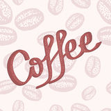 Hand drawn coffee lettering scattered on the background of coffee beans. Royalty Free Stock Photography