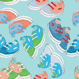 Colorful newborn shoes for boys. Seamless pattern. Vector illustration on light turquoise background. Hand drawn colorful newborn shoes for boys. Seamless vector illustration