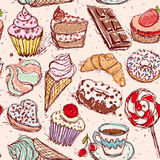 Hand drawn confectionery seamless pattern croissant Cupcake candy marshmallow ice cream cake donut and coffee. Royalty Free Stock Photo