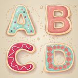 Hand drawn cookie letters. Hand drawn letters of the alphabet A through D in the shape of delicious and colorful cookies royalty free illustration
