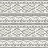 Hand drawn cozy winter sweater texture in colors of gray and beige. Knitted vector pattern with christmas geometric ornament. Hand drawn cozy winter sweater Stock Images