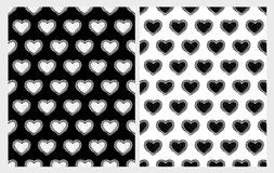 Hand Drawn Cute Hearts Vector Patterns Set. White and Black Infantile Graphic. Regular Design. White and Black Backgrounds. Cute Childish Style Design. Tiny royalty free illustration