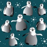 Dancing cute penguins with snowflakes seamless pattern. Vector illustration on dark blue background Stock Photos