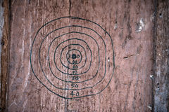 Hand drawn dartboard on a wooden board Royalty Free Stock Image