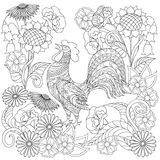 Hand drawn decorated rooster into flowers in ethnic style. Hand drawn decorated rooster and flowers in ethnic style isolated on white. Image for adult and Stock Photos