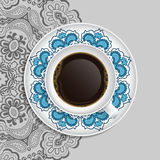 Cup of coffee and decorative ornament on a saucer  Stock Photo