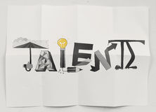 Hand drawn  design word Talent on crumpled paper background  as Stock Photography