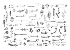 Hand drawn different elements. Vector set of decorative arrows, feathers, floral objects, lines, dividers and border. Templates of symbols for use in design Stock Images