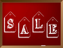 Hand drawn discount labels on chalkboard with sale text Stock Image