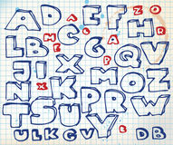 Hand drawn doodle alphabet. On squared paper stock illustration