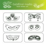 Hand drawn doodle carnival masks set. Vector illustration.  elements on white background. Symbol collection Stock Photos