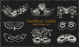 Hand drawn doodle carnival masks set. Vector illustration. Isolated elements on chalkboard background. Symbol collection Stock Image