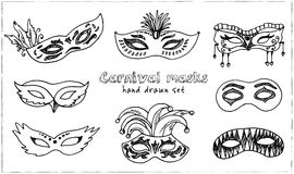 Hand drawn doodle carnival masks set. Royalty Free Stock Photography