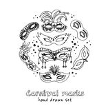 Hand drawn doodle carnival masks set. Vector illustration. Isolated elements on white background. Symbol collection Royalty Free Stock Photography