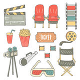 Hand drawn doodle cinema industry objects set. Hand drawn doodle cinema industry objects collection including chair, popcorn, soda, film, camera, glasses Stock Images