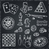 Hand drawn doodle Games set. Chess piece, casino  roulette, cards, billiards. Royalty Free Stock Photography