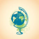 Hand drawn doodle globe. Brown pen outline, green watercolor grunge background. Geography, school, education. Royalty Free Stock Photo