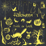 Hand drawn doodle halloween party elements. Yellow objects, black watercolor background. Design illustration for poster Royalty Free Stock Photo